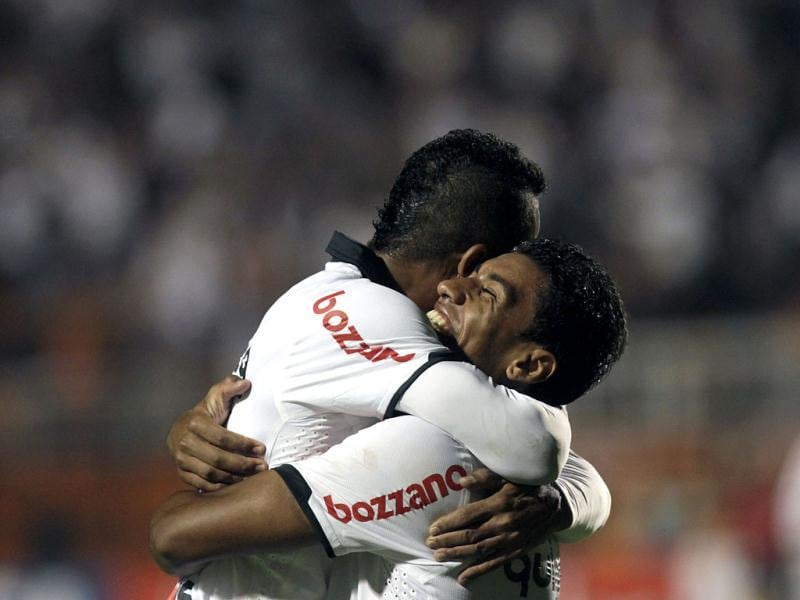 Brazil's Corinthians' Jorge Henrique, left, celebrates with teammate Paulinho after scoring against Venezuela's Deportivo Tachira during a Copa Libertadores soccer match in Sao Paulo, Brazil. (AP Photo/Andre Penner)