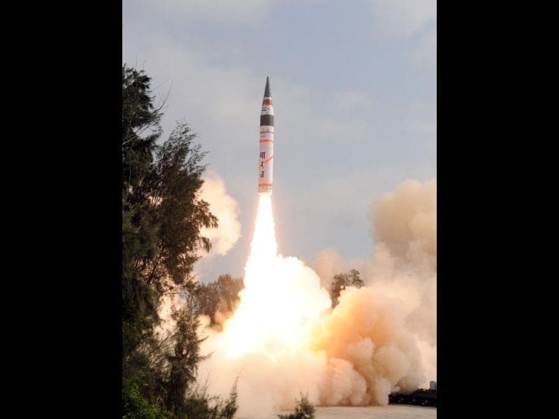 Photo released by DRDO shows missile Agni V being fired off from Wheeler Island, off Orissa coast. AFP photo