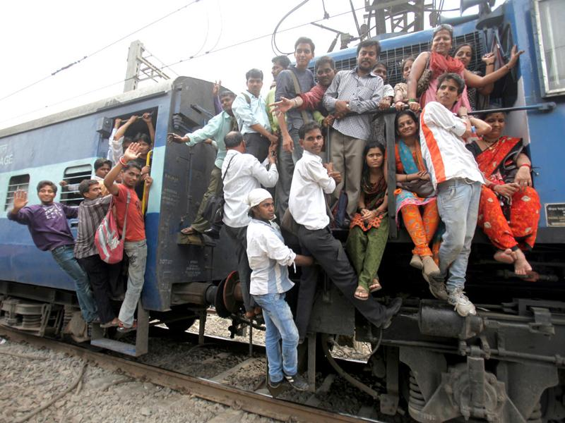 Commuters travel on a train engine of an overcrowded local train at Vidyavihar, Mumbai. Train services were disrupted after a fire in a signal cabin near Kurla. HT Photo/Kunal Patil
