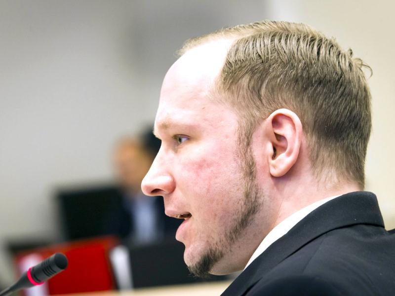 Self-confessed mass murderer and right-wing extremist Anders Behring Breivik talks on his fourth day of proceedings in courtroom 250 at Oslo's courthouse. Breivik, who killed 77 people in Norway last July, refrained from making his habitual far-right salute Thursday after objections from survivors and victims' families. AFP PHOTO