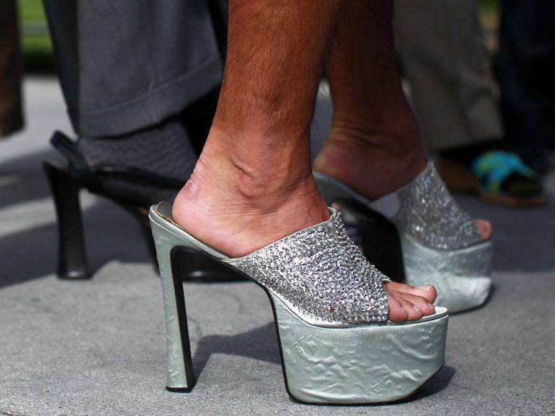 A man wearing a pair of women's high heels attends the 10th annual Walk A Mile In Her Shoes to raise awareness against sexual violence in Plaza De Cesar Chavez in San Jose, California. REUTERS/Stephen Lam