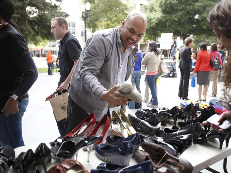 Blake Balajadia, of San Jose, reacts after finding a pair of women's high heels to wear during the 10th annual Walk A Mile In Her Shoes to raise awareness against sexual violence in Plaza De Cesar Chavez in San Jose, California. REUTERS/Stephen Lam