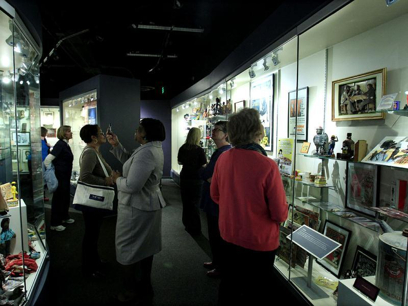 Visitors look over displays at the Jim Crow Museum of Racist Memorabilia in Big Rapids, Mich. The museum says it has amassed the nation's largest public collection of artifacts spanning the segregation era, from Reconstruction until the civil rights movement, and beyond. AP Photo/Carlos Osorio