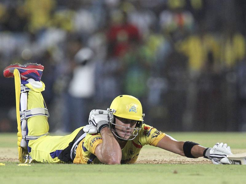 Chennai Super Kings batsman Faf du Plessis attempts to avoid getting run out during the IPL Twenty20 cricket match in Chennai. (AFP Photo/Seshadri Sukumar)