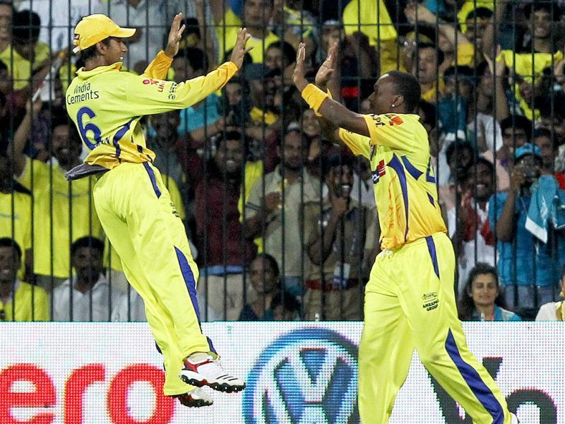 Chennai Super Kings players celebrating the wicket of Pune Warriors' Jesse Ryder during the IPL-5 match in Chennai. (PTI PhotoR Senthil Kumar)