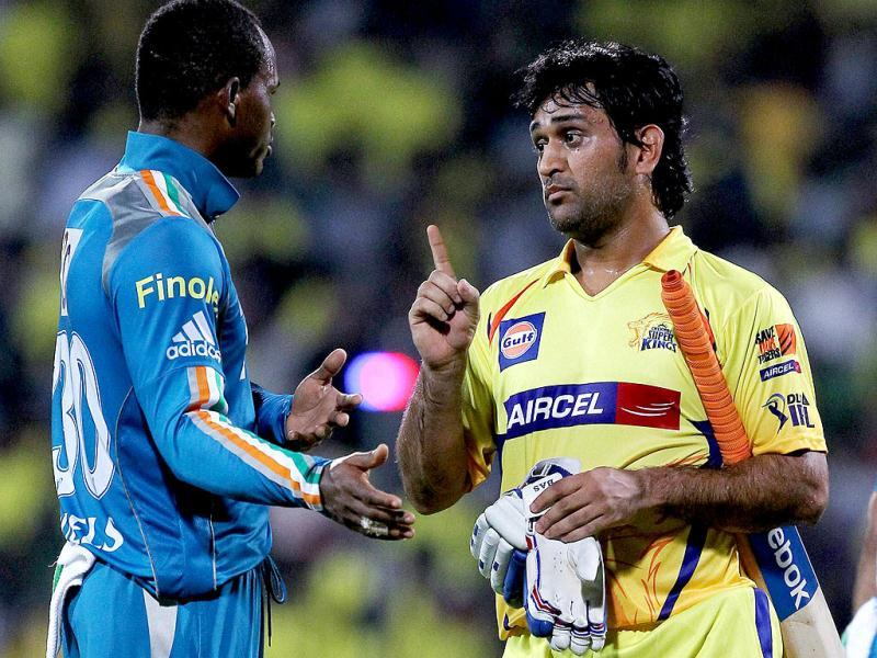 Chennai Super Kings' skipper MS Dhoni have a chat with Pune Warriors' Marlon Samuels during the IPL-5 match in Chennai. (PTI PhotoR Senthil Kumar)