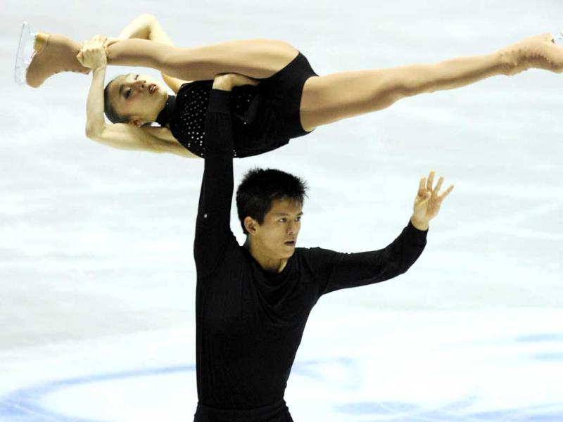 Japan's pair, Narumi Takahashi (top) and Mervin Tran perform during the short program event of the World Team Trophy 2012 figure skating competition in Tokyo. AFP PHOTO / TOSHIFUMI KITAMURA