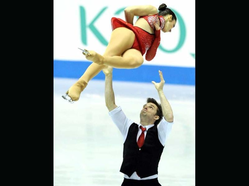 Italy's pair, Stefania Berton (top) and Ondrej Hotarek performs during the short program event of the World Team Trophy 2012 figure skating competition in Tokyo.  AFP PHOTO / TOSHIFUMI KITAMURA