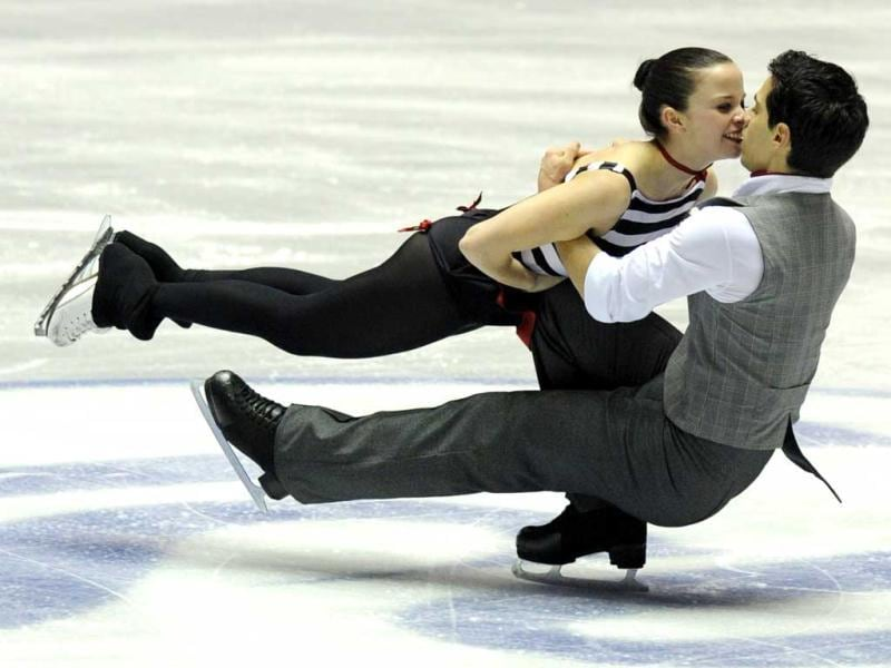 Italy's Ice Dance pair, Anna Cappellini (L) and Luca Lanotte perform during the free dance event of the World Team Trophy 2012 figure skating competition in Tokyo.  AFP PHOTO / TOSHIFUMI KITAMURA