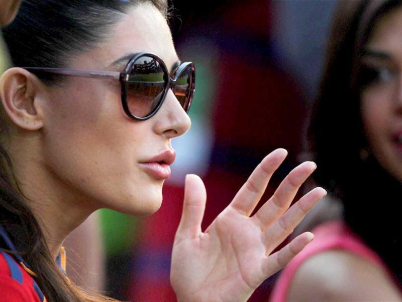 Nargis Fakhri looks engrossed in the match.