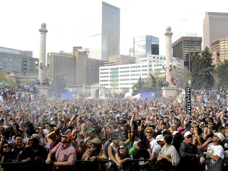 A cloud of smoke covers the crowd at 4.20pm at Denver 420 rally in Civic Center Park. AP Photo/The Denver Post, Hyoung Chang