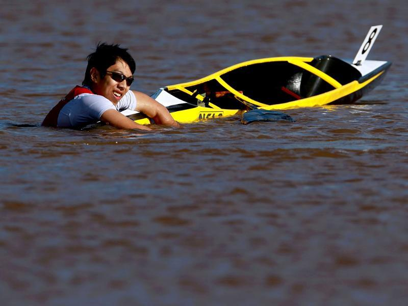 Wilbert Lam falls in the water during the Men's Kayak 200m heat final for the 2012 US Olympic Team Trials at the Boathouse District on the Oklahoma River. AFP
