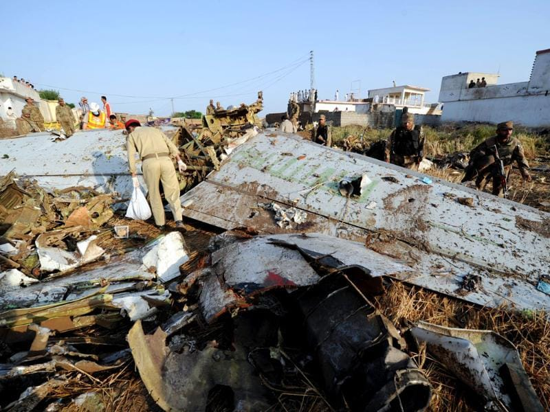 Pakistani soldiers search through debris in Hussain Abad after a Bhoja Air Boeing 737 plane crashed on the outskirts of Islamabad. AFP Photo/Aamir Qureshi