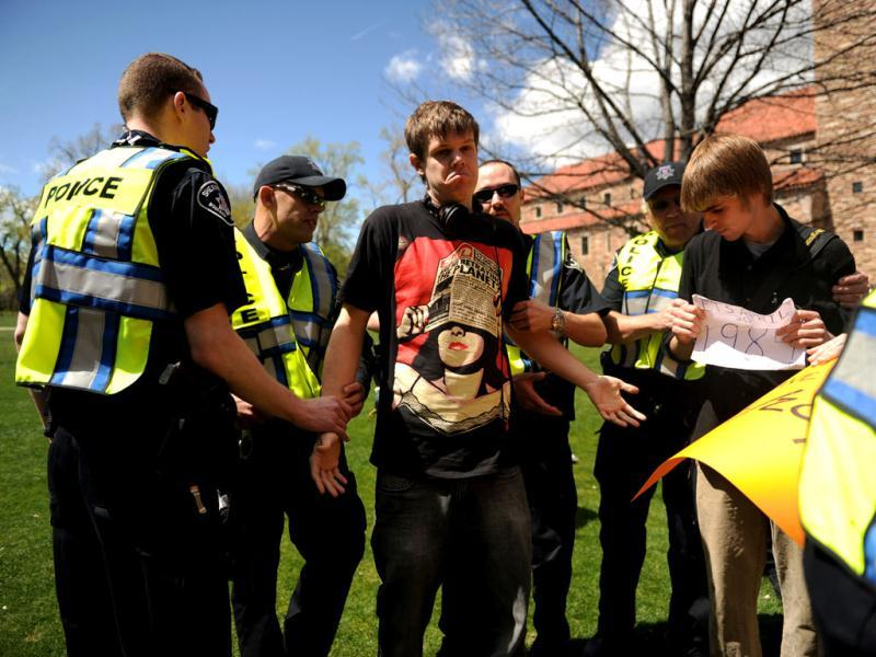 Colorado University senior Gabriel Kuettel is arrested for trespassing on the Norlin Quad which was closed to crackdown on pro-marijuana protesters at the school in Boulder, Colo. A block-long line of protesters marched onto the University of Colorado, testing the school's determination to push the annual marijuana celebration off campus. (AP Photo/The Denver Post, Joe Amon)