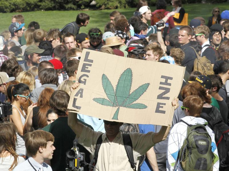 Students and others smoke marijuana at a pro-marijuana rally at the University of Colorado in Boulder, Colorado. The University of Colorado clamped down on a huge annual marijuana fest by restricting access to the school and a field where the