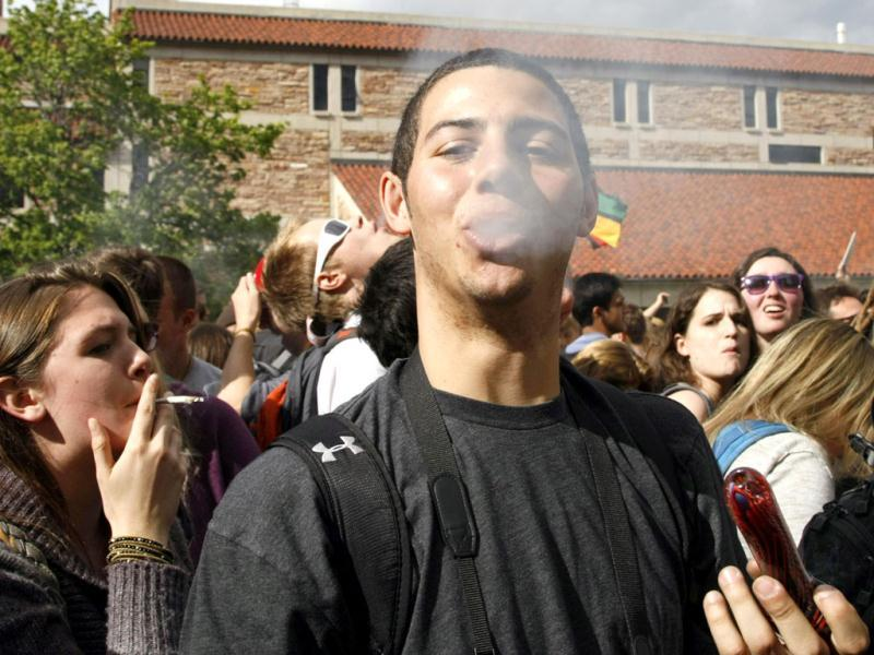 A man exhales after smoking marijuana in a pipe at a pro-marijuana rally at the University of Colorado in Boulder, Colorado. The University of Colorado clamped down on a huge annual marijuana fest on Friday by restricting access to the school and a field where the