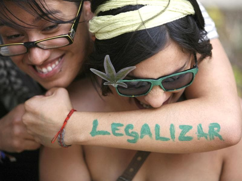 A woman embraces her friend during a 4/20 rally to demand the legalization of marijuana outside the Senate building in Mexico City. Marijuana enthusiasts across the world gather every year on April 20 for an international celebration-cum-protest for marijuana legalization. The words read,