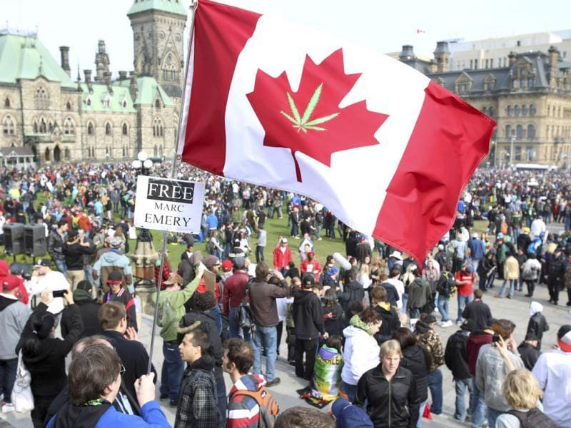 A Canadian flag with a marijuana leaf is flown during a 4/20 rally to demand the legalization of marijuana on Parliament Hill in Ottawa. Marijuana enthusiasts across Canada gather by the thousands every year on April 20 for an international celebration-cum-protest for marijuana legalization.  REUTERS/Patrick Doyle