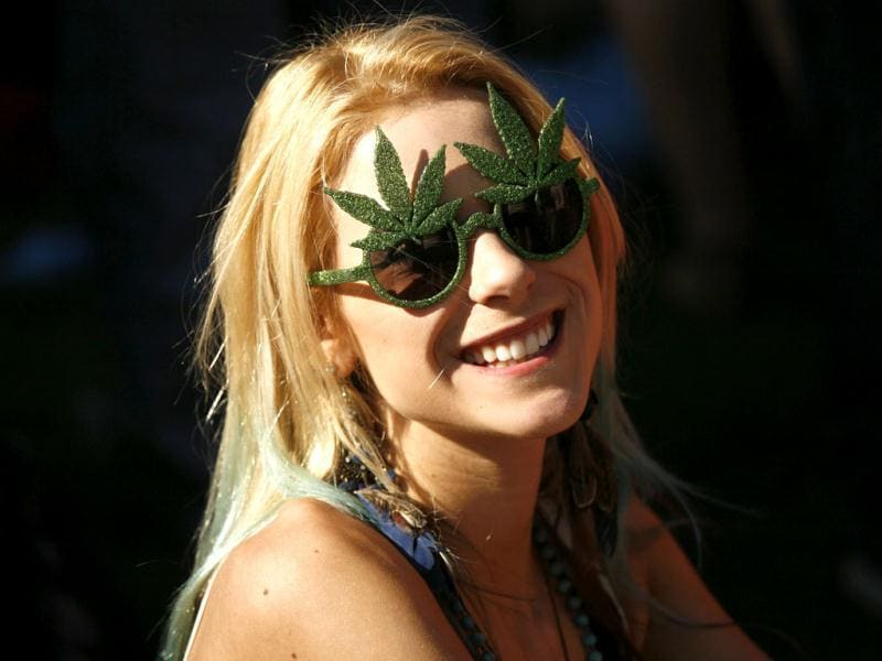 A woman with glasses shaped like a marijuana leaves smiles during a gathering of marijuana advocates at Golden Gate Park in San Francisco, California. The event was held on April 20, a date corresponding with a numerical 4/20 code widely known within the cannabis subculture as a symbol for all things marijuana. REUTERS/Robert Galbraith