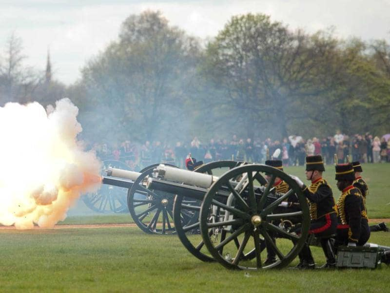 Gun teams from the The Kings Troop of the Royal artillery fire a 41 gun salute in London's Hyde Park in honour of her Royal Highness Queen Elizabeth II's 86th birthday in central London. AFP Photo / Leon Neal