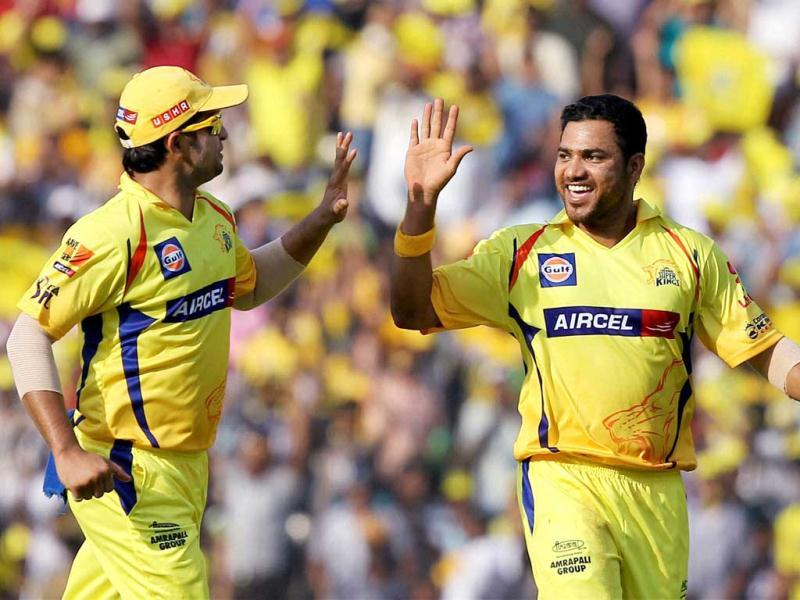 Chennai Super Kings' Shadab Jakati along with Suresh Raina celebrating the wicket Rahul Dravid during the IPL-5 match in Chennai. (PTI Photo/R Senthil Kumar)