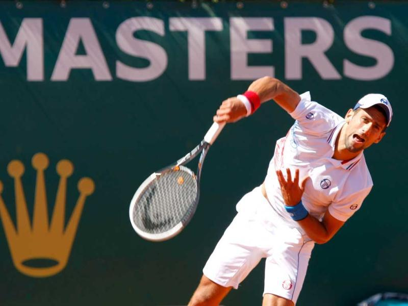 Serbia's Novak Djokovic serves the ball to Netherlands' Robin Haase, during their quarterfinal match of the Monte Carlo Tennis Masters tournament, in Monaco. (AP Photo/Claude Paris)