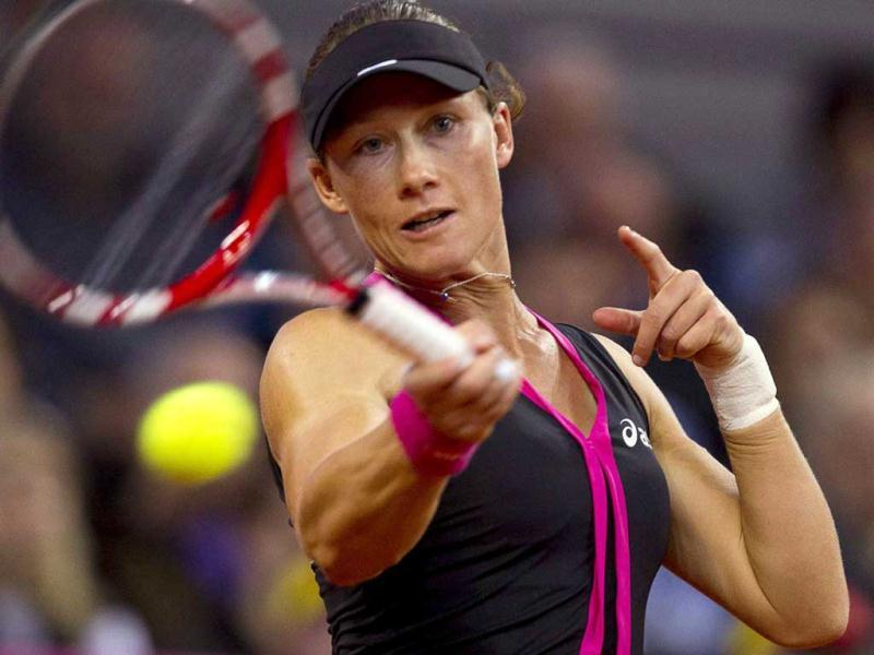 Australia's Samantha Stosur returns the ball to Germany's Angelique Kerber during their Fed Cup World Group tennis match in Stuttgart. (Reuters/Thomas Peter)