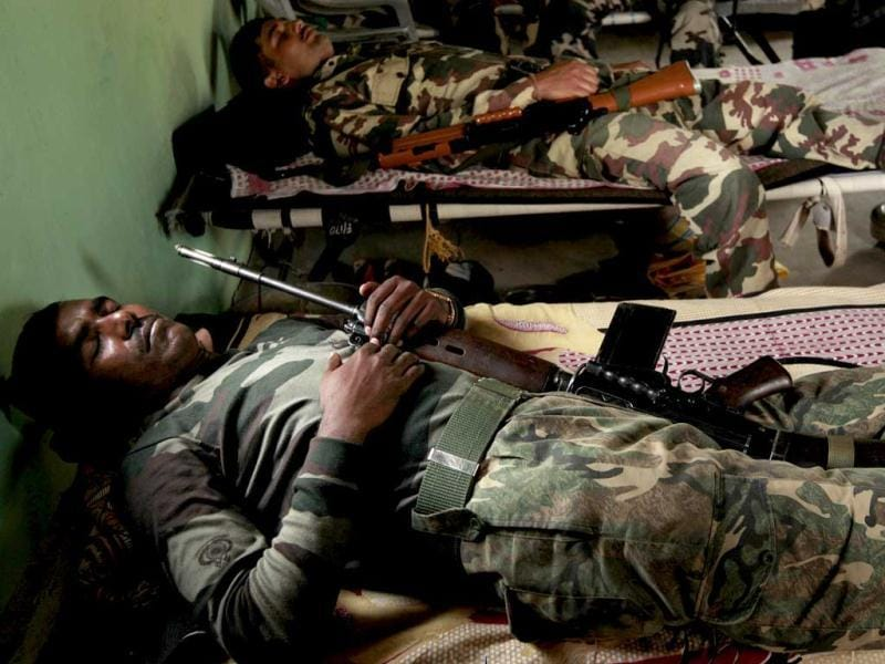 CRPF jawans sleeping in their camp after an operation against Naxals in a forest of Bijapur, Chattisgarh. Even within the confines of the camp, danger lurks. So the troops have to sleep with loaded automatic rifles within handy reach on their beds. HT Photo/Ajay Aggarwal