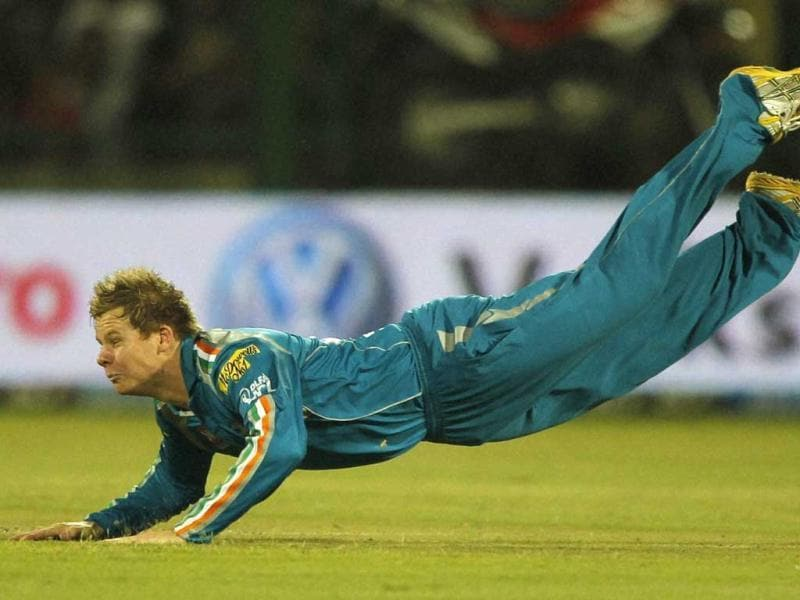 Pune Warriors' Steven Smith dives to stop the ball while fielding against Delhi Daredevils during their IPL-5 match in New Delhi. (PTI Photo/Aman Sharma)