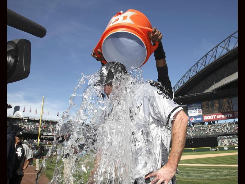 Starting pitcher Philip Humber #41 of the Chicago White Sox is doused with water by a teammate after throwing a perfect game against the Seattle Mariners at Safeco Field in Seattle, Washington. AFP