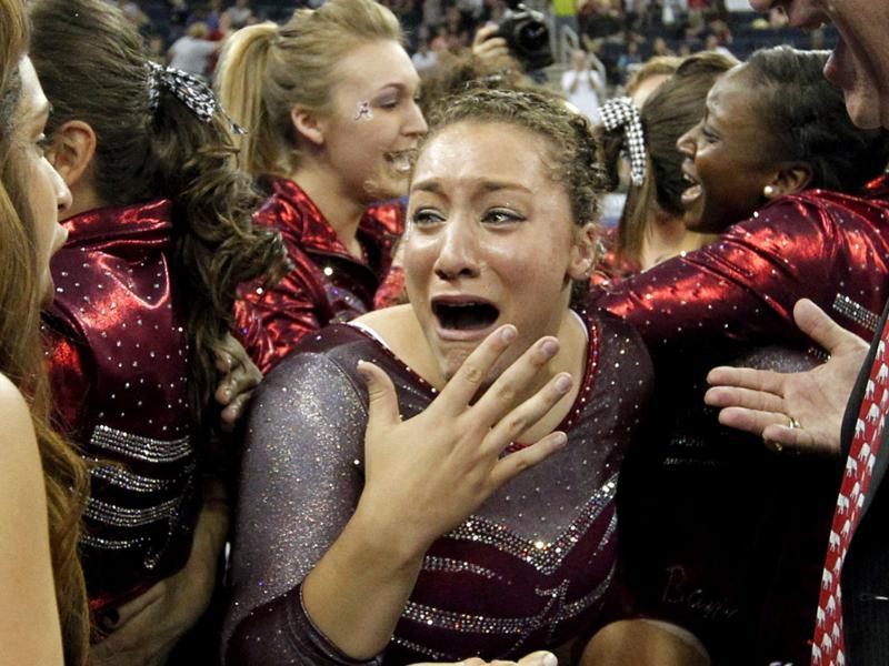 Alabama's Kayla Williams reacts after her team won the NCAA women's gymnastics championships in Duluth, Ga. AP Photo/John Bazemore