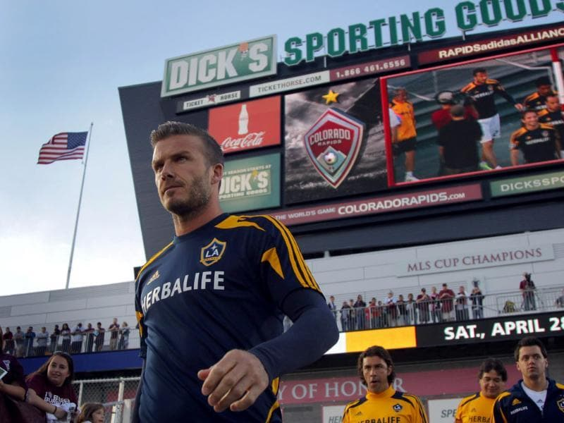 David Beckham #23 of the Los Angeles Galaxy takes the field for warm up prior to facing the Colorado Rapids at Dick's Sporting Goods Park. AFP