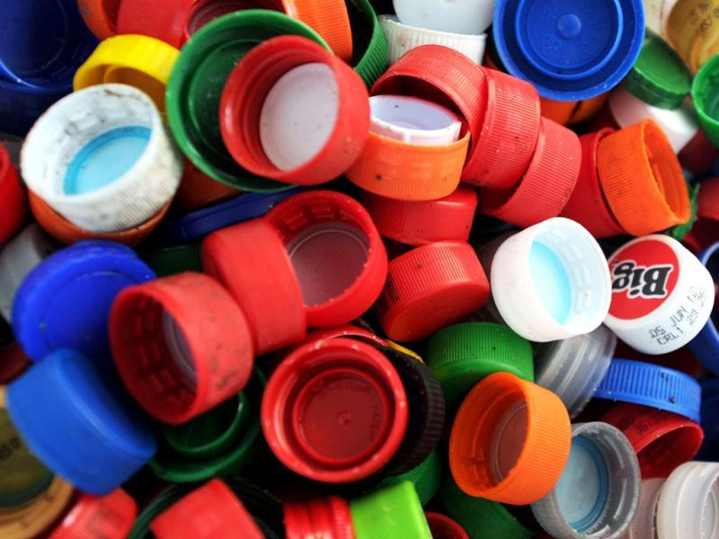 Picture of recyclable plastics screw tops taken at a classification plant in Juan Vinas, on the outskirts of San Jose, Costa Rica. Activists across the globe will celebrate Earth Day on April 22 with events aimed at bringing awareness of environmental concerns.  AFP PHOTO/Rodrigo ARANGUA