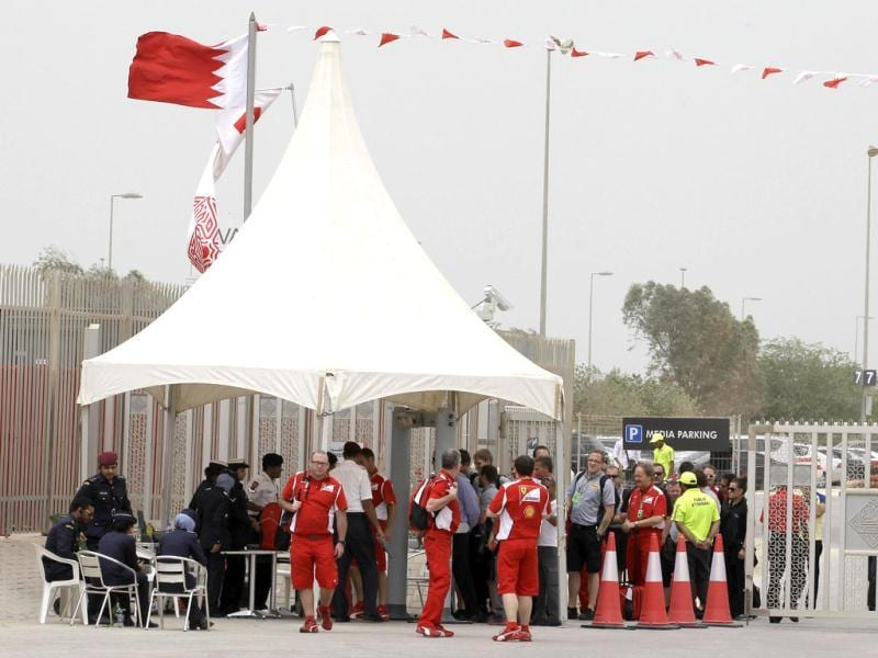 Police and security officers check journalists and Formula One team staff at a gate of the Formula One Bahrain International Circuit in Sakhir, Bahrain. (AP Photo/Hassan Ammar)