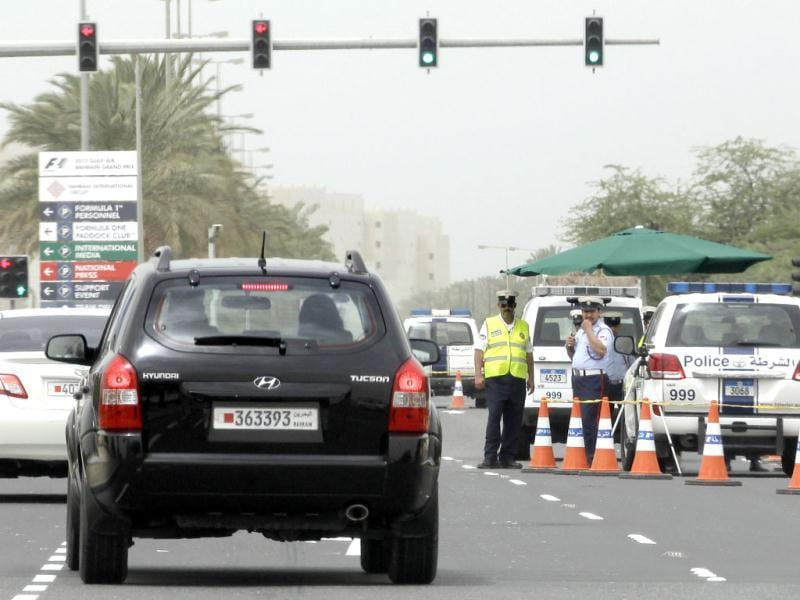 Police officers man a checkpoint outside the Formula One Bahrain International Circuit in Sakhir, Bahrain. (AP Photo/Hassan Ammar)