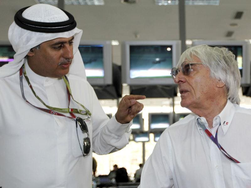 Zayed Alzayani, left, chairman of the Bahrain International Circuit, gestures to Bernie Ecclestone, president and CEO of the Formula One Management, prior to the start of the Bahrain Formula One Grand Prix at the Formula One Bahrain International Circuit in Sakhir, Bahrain. (AP Photo/Luca Bruno)