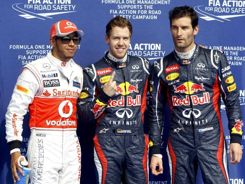 Pole position Red Bull Formula One driver Sebastian Vettel (C) of Germany, second qualified McLaren Formula One driver Lewis Hamilton (L) of Britain and third qualified Red Bull Formula One driver Mark Webber of Australia pose after the qualifying session of the Bahrain F1 Grand Prix at the Sakhir circuit in Manama. REUTERS/Ahmed Jadallah