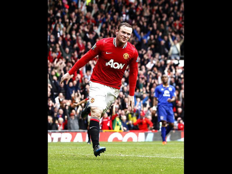 Manchester United's Wayne Rooney reacts after scoring his second goal against Everton during their English Premier League soccer match at Old Trafford Stadium, Manchester, England. (AP Photo/Jon Super)