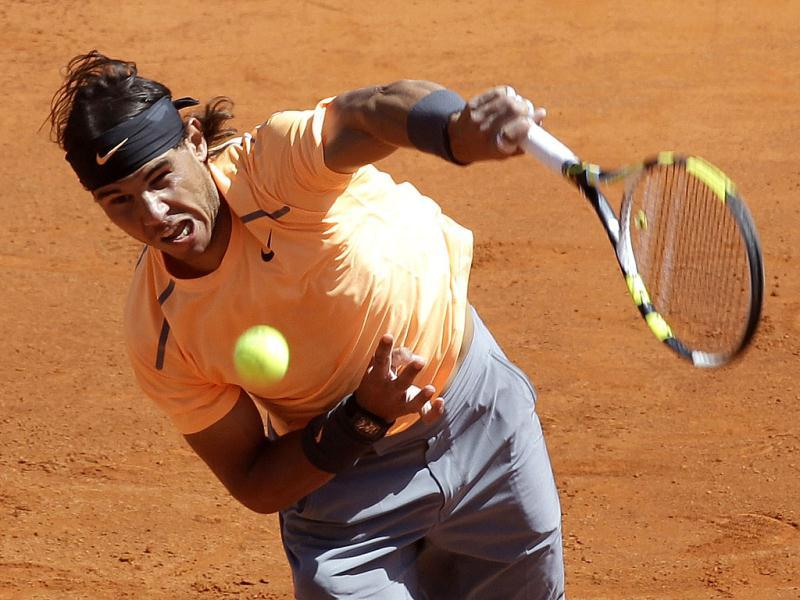 Spain's Rafael Nadal plays a return to Novak Djokovic of Serbia during their final match of the Monte Carlo Tennis Masters tournament in Monaco. (AP Photo/Lionel Cironneau)