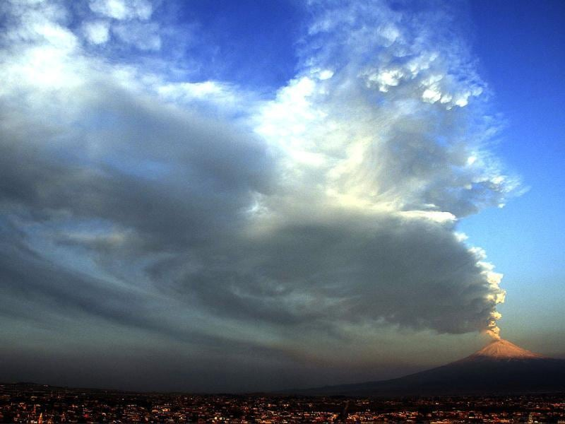 A plume of ash and steam rise from Popocatepetl Volcano seen from San Andres Cholula, Mexico. AP Photo