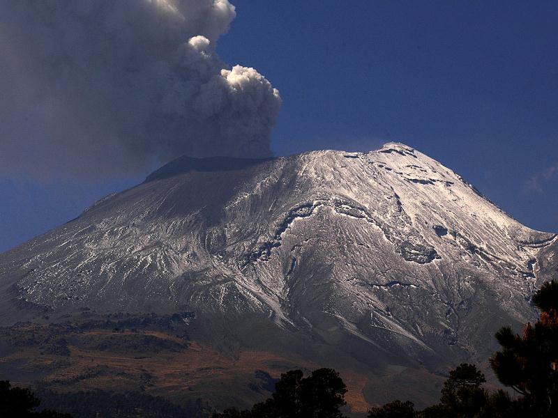 A plume of ash and smoke rises from the Popocatepetl Volcano seen from the outskirts of the town of Santiago Xalizintla, Mexico. AP Photo/Gonzalo Perez