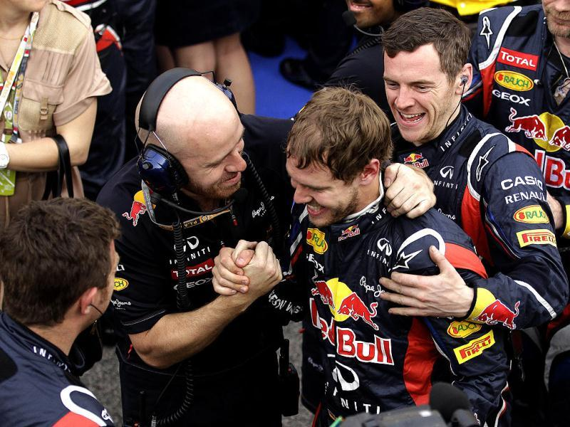 Red Bull driver Sebastian Vettel of Germany, second right, celebrates with his teammates after winning the Bahrain Formula One Grand Prix at the Bahrain International Circuit in Sakhir, Bahrain. (AP Photo/Hassan Ammar