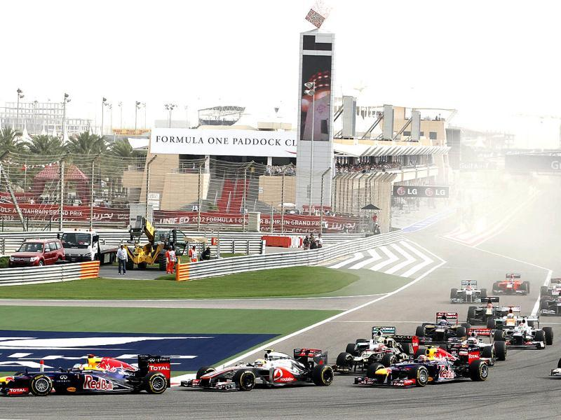 Red Bull driver Sebastian Vettel of Germany, leads the field after the start during the Bahrain Formula One Grand Prix at the Formula One Bahrain International Circuit in Sakhir, Bahrain. (AP Photo/Luca Bruno)