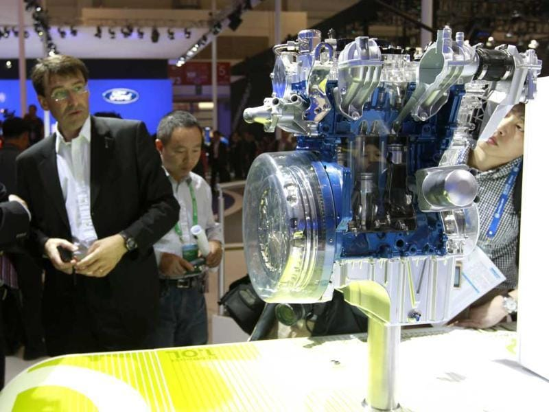 Visitors look at Ford's EcoBoost 1.0 liter engine at the Beijing International Auto Exhibition in China. AP Photo/Vincent Thian