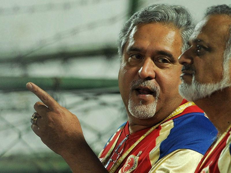 Royal Challengers Bangalore team owner Vijay Mallaya gestures during the IPL 5 cricket match in Jaipur. AFP Photo/Manan Vatsyayana