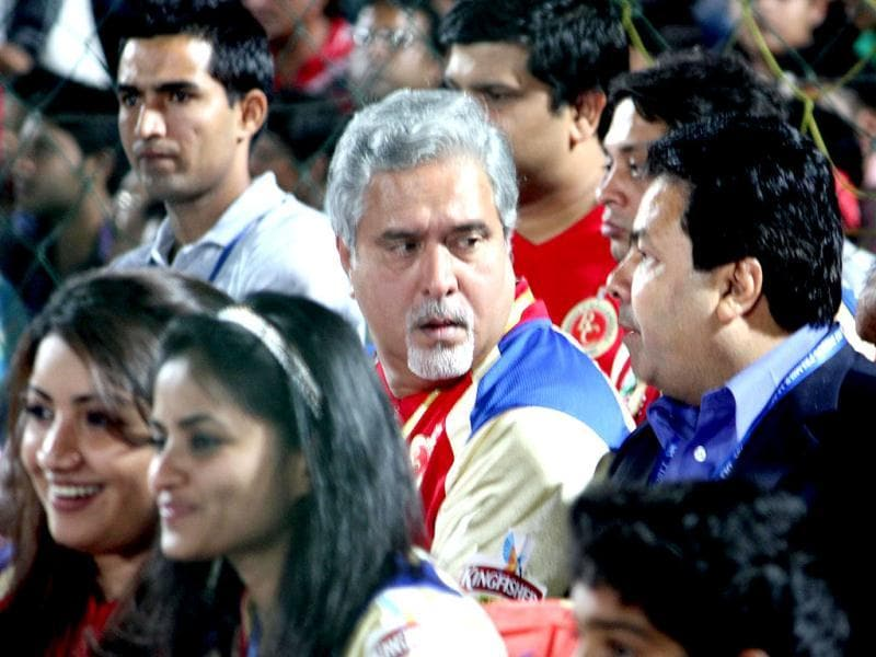 IPL chairman Rajiv Shukla and Royal Challengers Bangalore owner Vijay Mallya interacting during the IPL match at the Sawai Mansingh Stadium in Jaipur.