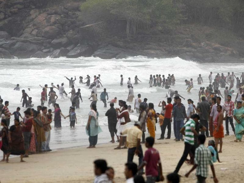 People spend an evening at the Kovalam beach on the Arabian Sea coast in Trivandrum. Kovalam beach is one of the major tourist attractions in India. AP Photo/Aijaz Rahi