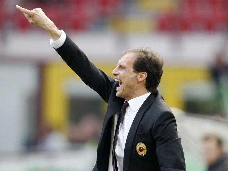 AC Milan coach Massimiliano Allegri gestures during the Serie A soccer match between AC Milan and Bologna at the San Siro stadium in Milan, Italy. AP Photo/Antonio Calanni