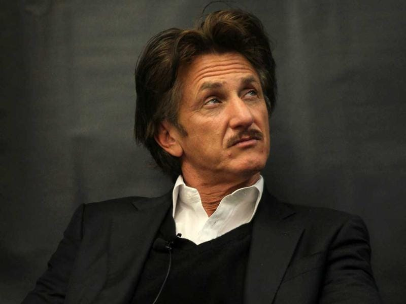 Actor and philanthropist Sean Penn listens as former Russian President Mikhail Gorbachev speaks with students at Frederick Von Steuben Metropolitan Science Center as part of the World Summit of Nobel Peace Laureates in Chicago, Illinois. Scott Olson/Getty Images/AFP