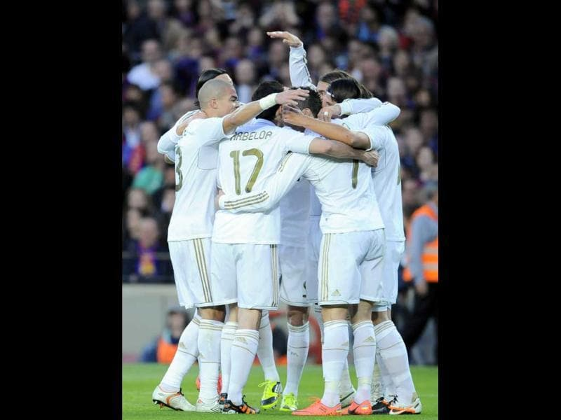 Real Madrid's teammates celebrate after Mesut Ozil from Germany scored against FC Barcelona during their Spanish La Liga soccer match, at Camp Nou stadium in Barcelona, Spain. AP/Alvaro Barrientos